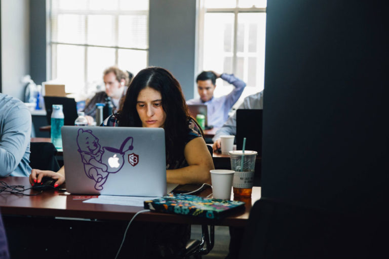 woman learning to code at a Software Guild coding bootcamp